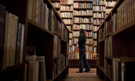 A librarian stands in Mexico City's City of Books library.