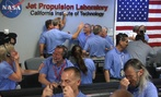 NASA staff at the Jet Propulsion Laboratory celebrate the landing of Curiosity.