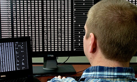 A cybersecurity analyst looks at code in the Homeland Security Department's malware laboratory.