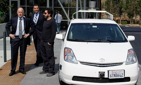 From left, California Gov. Edmund Brown, state Senator Alex Padilla and Google co-founder Sergey Brin stand by a driverless car at Google headquarters.