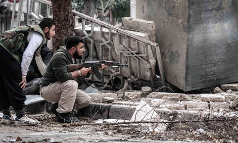 Syrian rebel fighters take cover in southeast Aleppo.