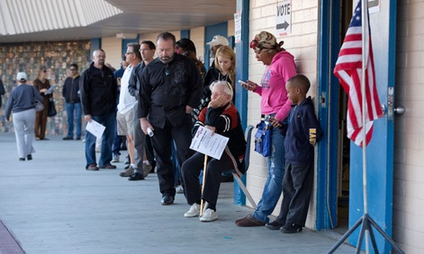 Voters wait -- and tweet on their phones -- in Las Vegas outside a poling place.