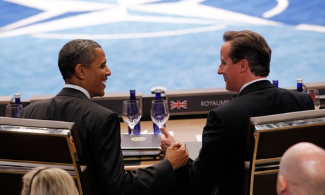 Obama and Cameron commiserate during a NATO meeting in May.