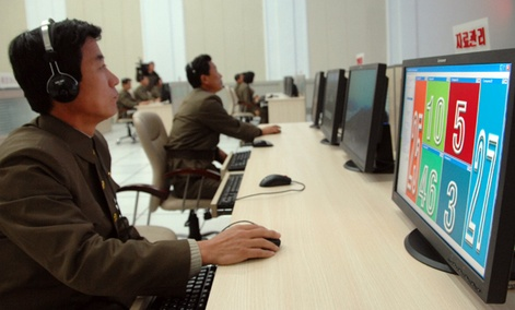 Scientists and technicians work on their computers to control the launch of North Korea's Unha-3 rocket  in Pyongyang, North Korea on Dec. 12, 2012.