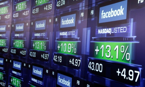 Electronic screens show the price of Facebook shares after they began trading Friday, May 18, 2012 in New York.