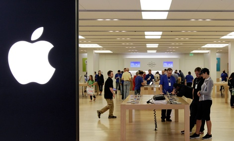 People shop in an Apple store at a mall in Cheektowaga, N.Y.