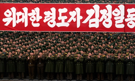 North Korean soldiers applaud during a mass rally organized to celebrate the success of a rocket launch.