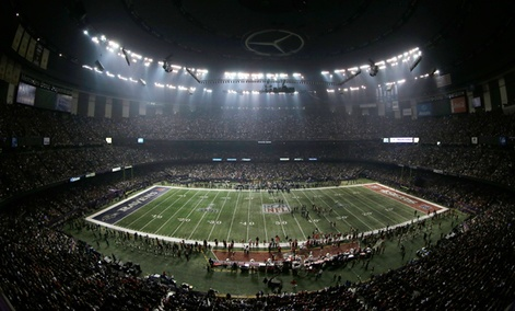 Fans and members of the Baltimore Ravens and San Francisco 49ers wait for power to return in the Superdome.