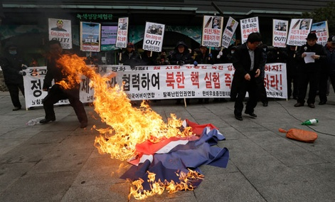South Korean protesters burn a North Korean flag during an anti-North Korea rally in Seoul Tuesday.