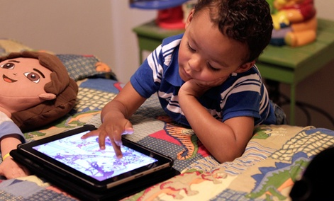 Frankie Thevenot, 3, plays with an iPad in his bedroom at his home in Metairie, La.