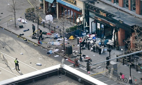 Police clear the scene after Monday's bombing in Boston.