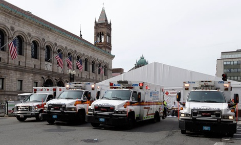 Ambulances wait near the medical tent at the Boston Marathon Monday.