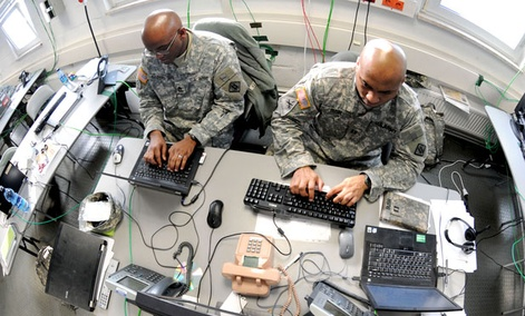 aster Sgt. Charlie Sanders (left) and Capt. Lashon Bush work on a Mission Event Synchronization List in the Joint Cyber Control Center at Grafenwoehr, Germany