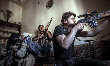 A rebel sniper aims at Syrian army positions in the Aleppo Jedida district, Syria.