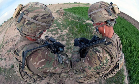 U.S. Army paratroopers compare their wrist units equipped with global positioning during a foot patrol in Afghanistan's southern Ghazni province, May 8, 2012.