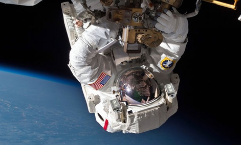 Astronaut Chris Cassidy and Tom Marshburn, not pictured, perform a space walk to inspect and replace a pump controller box on the International Space Station on May 11, 2013.