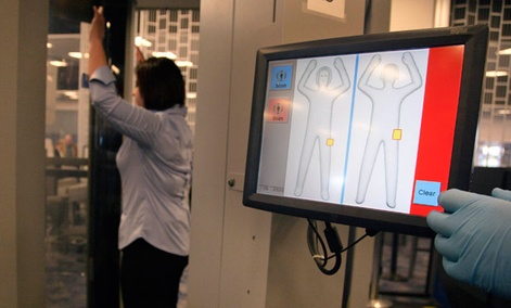 A TSA employee demonstrates an Advanced Imaging Technology scanner at Las Vegas' McCarran International Airport in 2011.