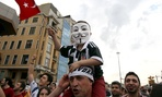 A boy on a man's shoulders wears a Guy Fawkes mask during the third day of anti-government protests in Istanbul.