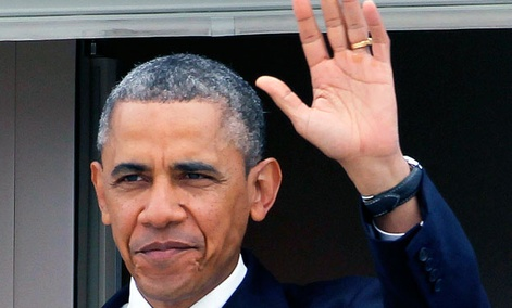 President Barack Obama waves as he arrives at Los Angeles International Airport, Friday, June 7, 2013, to meet with the Chinese President Xi Jinping.