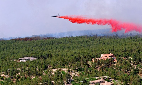 A DC-10 airtanker drops chemicals to contain fires in Colorado this week.