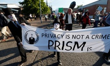 Protestors gather during a demonstration outside of the security perimeter of the G-8 summit in Enniskillen, Northern Ireland Monday.