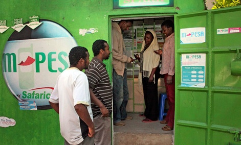 Customers make money transfers at an M-Pesa counter in Nairobi, Kenya. A mobile banking service, M-Pesa allows people without a bank account to transfer money between phones instantly.