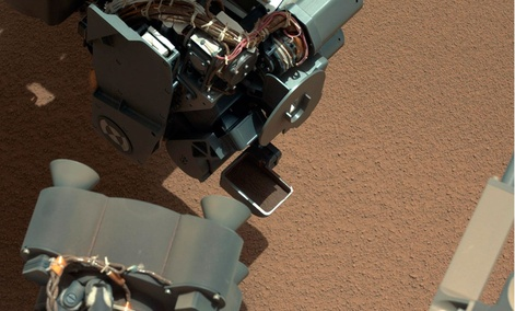 This image from the right Mast Camera (Mastcam) of NASA's Mars rover Curiosity shows a scoop full of sand and dust lifted by the rover's first use of the scoop on its robotic arm.
