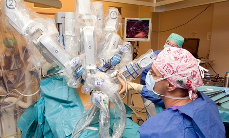 The da Vinci surgical robot system in action during a surgery.