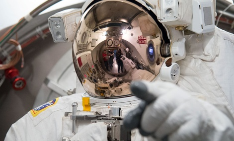 European Space Agency astronaut Luca Parmitano tests his spacesuit NASA's Johnson Space Center.