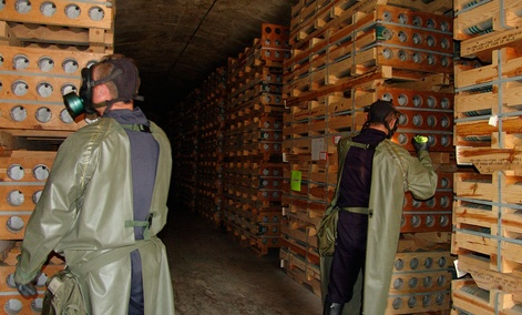 Workers inspect chemical agent munitions stored at the Blue Grass Army Depot in Kentucky. The Pentagon is seeking more than $700 million in fiscal 2014 funding for the agency assigned to destroy chemical stockpiles at Blue Grass.