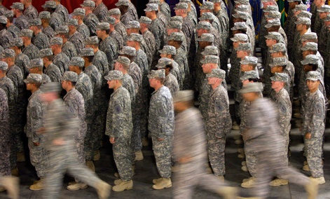 Members of the 1st Infantry Division fall in for a re-deployment ceremony upon return from Iraq to Fort Riley in 2009.