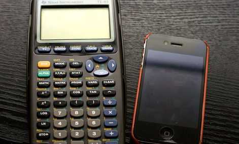 The TI-83 calculator matched up with an iPhone