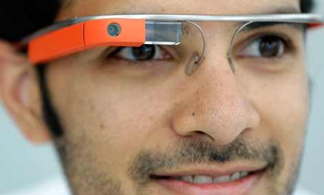Google Glass team member Salil Pandit wears Google Glasses at a booth at Google I/O 2013.