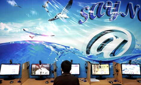 An Iranian man surfs the Internet at a cafe in Tehran, Iran.
