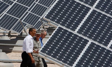 Barack Obama, Sen. Harry Reid, D-Nev.,  and Col. Howard Belote tour solar power panels at Nellis Air Force Base in 2009.