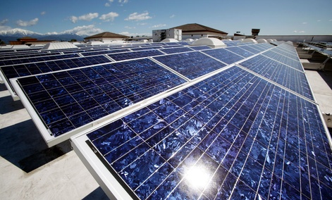 Solar panels are seen on the roof of a Wal-Mart Supercenter in Baldwin Park, California.