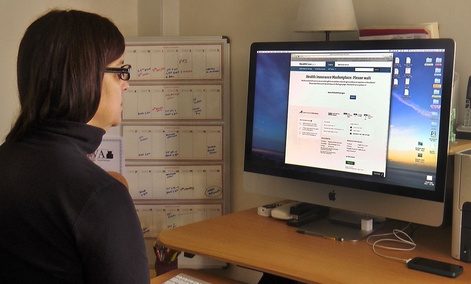 Deborah Lielasus tries to sign up for insurance on the Affordable Care Act website Oct. 1. She only got as far as creating account before getting frustrated with site problems.