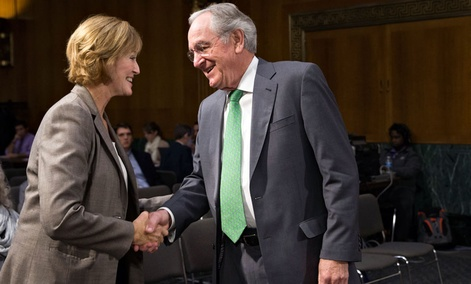 Medicare chief Marilyn Tavenner, left, is welcomed by Sen. Tom Harkin, D-Iowa.