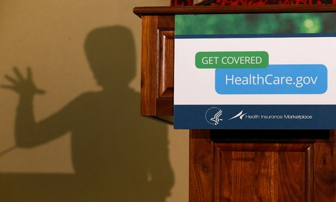 The shadow of Health and Human Services Secretary Kathleen Sebelius is shown as she speaks at the Community Health and Social Services Center in Detroit on Nov. 15.