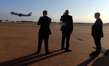 Secret Service agents watch as Air Force One departs in April.