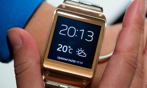 A model displays the new Samsung Galaxy Gear after a presentation in Berlin, Germany.