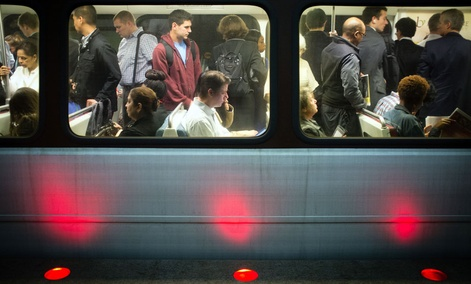 Passengers fill up Washington Metro subway cars in Arlington, Va.