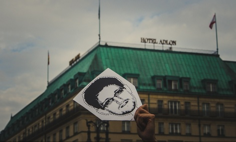 A protestor holds up an Edward Snowden mask in Berlin.