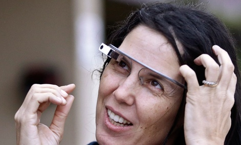 Cecilia Abadie wore her Google Glass as she talks with her attorney outside of traffic court in December.
