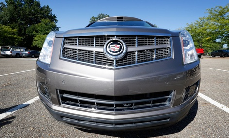 Infrared sensors and a low mounted camera can be seen below the bumper of this Cadillac SRX that was modified to be driverless by Carnegie Mellon University.
