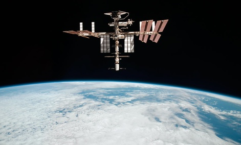 The International Space Station flying at an altitude of approximately 220 miles