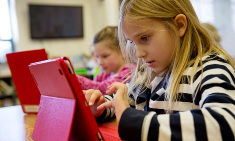 Ella Russell, 7, working on an e-book on an iPad during her second grade class at Jamestown Elementary School in Arlington, Va., in November.