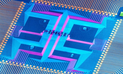 The DNA-sized nanowires in the center of this magnified chip could keep the electronics industry from burning out.