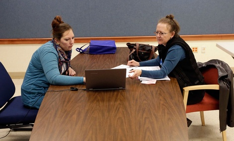Amanda Deardorff, left, a health enrollment navigator with Open Door Health Solutions, helps Valerie Kazer through the process of signing up for coverage under the Affordable Care Act in Muncie, Ind.