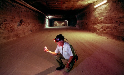 Sandia National Laboratories Senior Fellow Wendell Weart examines a salt crystal from the floor of one of the deep underground salt chambers excavated for transuranic nuclear waste storage at the Waste Isolation Pilot Plant east of Carlsbad, N.M.